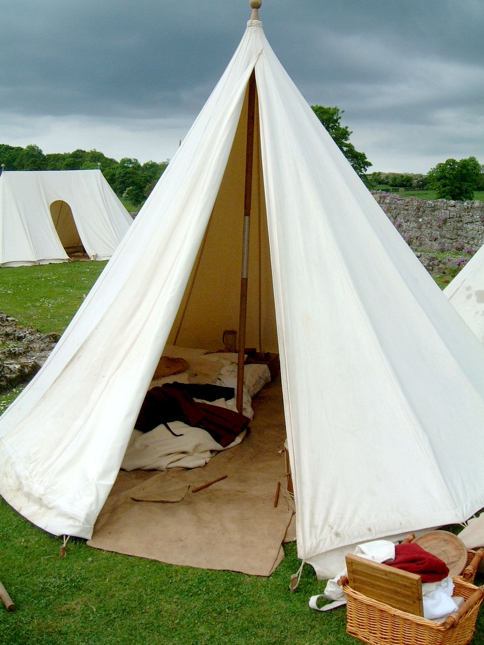 A shot of the interior of a taller tent (7 or 7 1/2 ft tall) showing a two-person bed on the left. & 15th century tent